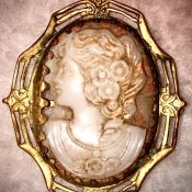 The front of a Victorian cameo brooch.