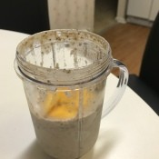 A blender cup filled with chia seed pudding.