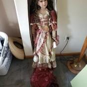 A decorative doll in a fancy dress.