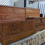 Two cedar chests with the lids open.