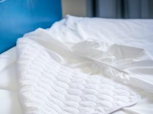A mattress topper on a bed.