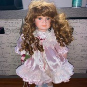 Value of a Brinn Porcelain Doll? - red haired doll in a pink dress