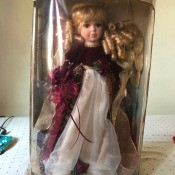 Value of a Collector's Choice Porcelain Doll? - angel doll in box