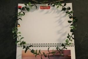 Dainty Wall Calendar Wreath  - wreath over the top page of a wall calendar