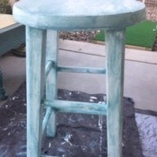 Distressed Finish Stool - wooden stool with a light blue distressed wash finish