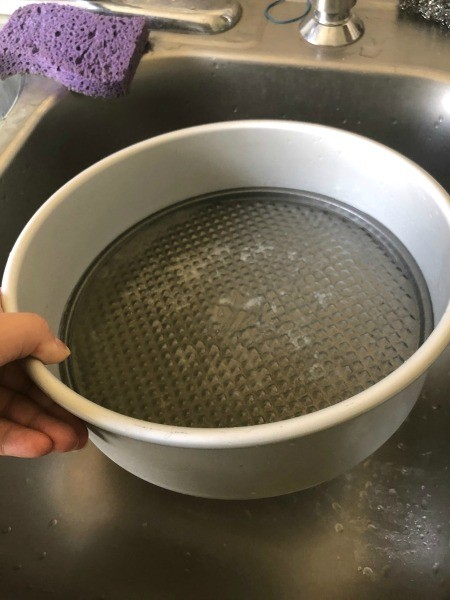 Two cake pans stuck together.
