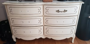 A white dresser with six drawers.