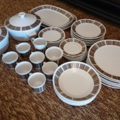 Set of china with a brown design.