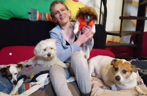 Slogan for Doggy Daycare and Boarding Business? - woman surrounded by dogs