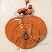 Lid Pumpkin Wall Hanging - finished pumpkin decor with faux sprig  and button glued in place