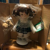 Value of Ashton Drake Irish Blessings Dolls? - girl doll in box with head, hands, and feet still in plastic