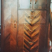 A wooden Art Deco wardrobe.