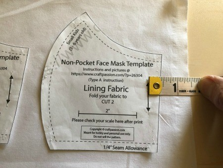 Non Pleated Child's Mask - measuring for placement on straight grain of fabric