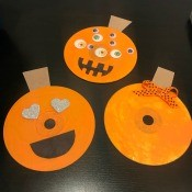 CD Pumpkin Wall Decorations - three finished pumpkins on black background