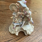 An old fashioned porcelain figurine couple.