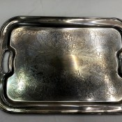 A silver tray with handles.
