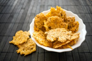 A bowl of homemade cheese crisps.