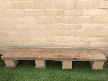 A low shelf on concrete blocks.