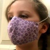 Non Pleated Child's Mask - child wearing the purple floral mask