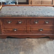 A Murphy hope chest with a padded seat.