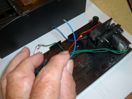 The wires in a card shuffler.