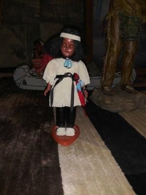 A plastic decorative Native American doll.