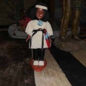 A plastic decorative Native American doll.