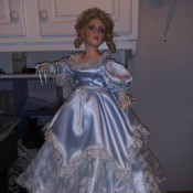 A porcelain doll in a blue dress.
