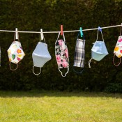 A collection of face masks hanging on a line.