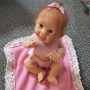 Value of Ashton-Drake Dolls? -baby doll on lace trimmed pink blanket