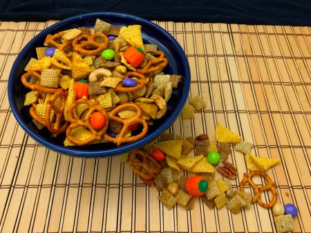 A bowl of Halloween Chex party mix.