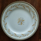 A china plate with a wheat design.