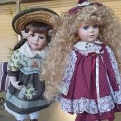 Identifying Porcelain Dolls? - two girl dolls in longish dresses