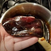 A dollop of sugar wax in a hand, ready for use.