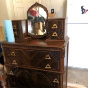 Value of 1934 Bassett Bedroom Set?- dresser with small mirror between two sets of small drawers on the top
