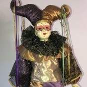 Information on a Brinn Porcelain Musical Jester?  - black, gold, and purple jester doll