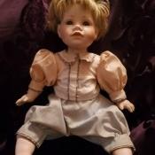 Identifying a Porcelain Doll? - doll sitting