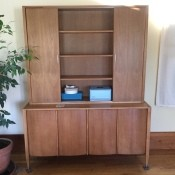 A wooden dining room cabinet.