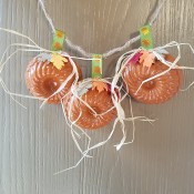 Mini Baking Tin Pumpkins - hanging on a door