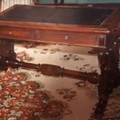 A wooden antique desk.