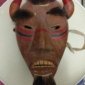 Painted mask with fur and horns.