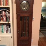 A wooden grandfather clock.