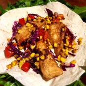 A flour tortilla filled with fish and fresh slaw.
