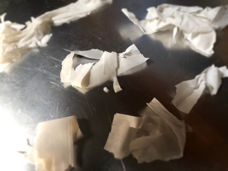 Pieces of phyllo dough on a cookie sheet.