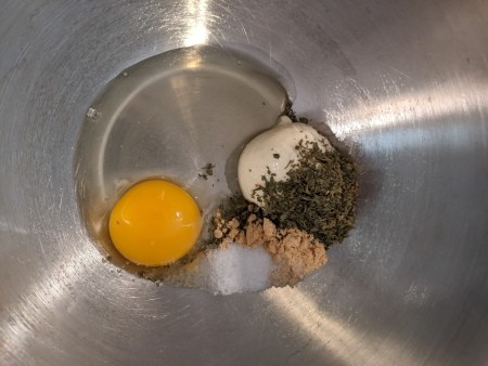 Adding egg and flavorings to a bowl.