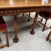 An ornately carved side to a dining room table.