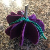 Five Minute Felt Pumpkin - finished purple pumpkin with teal embroidery floss tied to twig stem