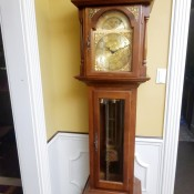 A tall wooden grandfather clock.