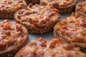 Slices of bread topped with pepperoni and cheese.