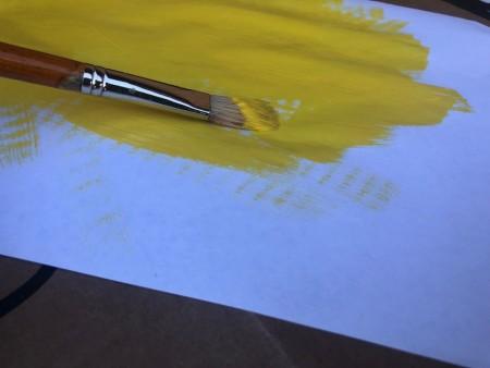 Cardboard Window Monster - painting white paper yellow